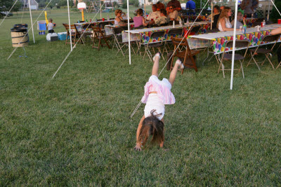 Sarah does cartwheels at Gunnar's birthday party