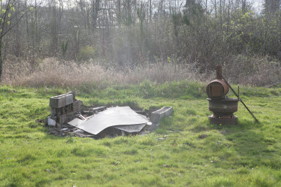 Garbage burning pit at farm in Montesano