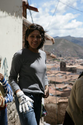 Amynah trying on some street vendor gloves in Cuzco, Peru
