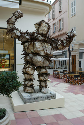 Large Man Statue Made of Boulders Held Together by Metal Rebar